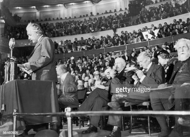 Albert Einstein German physicist creator of the relativity theory Albert Einstein emigrated from Germany attending a mass event at the London Albert...