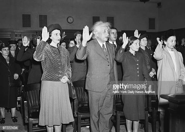 Albert Einstein is sworn in as an American citizen at the federal courthouse in Trenton NJ Flanking the father of the theory of relativity are two...