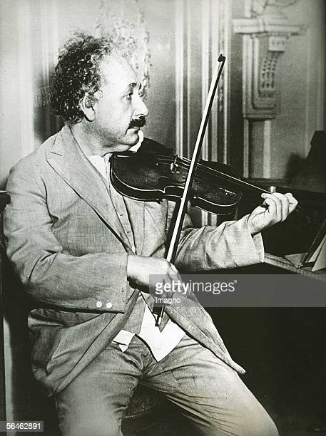 Albert Einstein playing the violin Photography Around 1925 [Albert Einstein beim Geigenspiel auf seiner Reise durch die USA Photographie Um 1925]