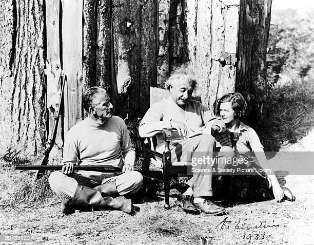 Albert Einstein the GermanSwissAmerican theoretical physicist with Commander Oliver LockerLempson MP and a young woman Einstein�s major contribution...