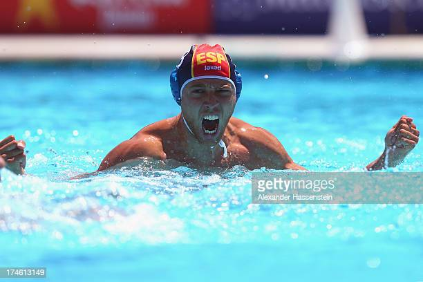 Albert Espanol of Spain celebrates during the Men's Water Polo quarterfinals qualification match between United States of America and Spain during...