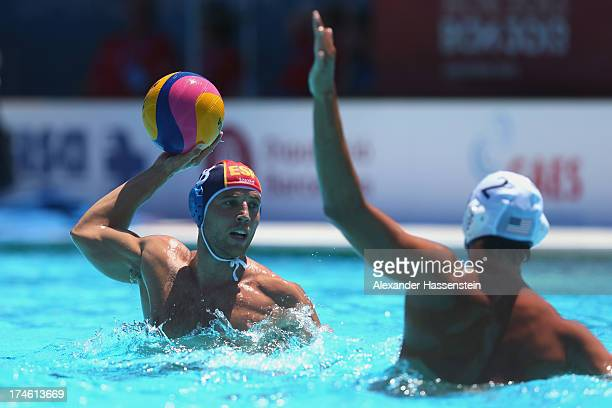 Albert Espanol of Spain in action with Janson Wigo of US during the Men's Water Polo quarterfinals qualification match between United States of...