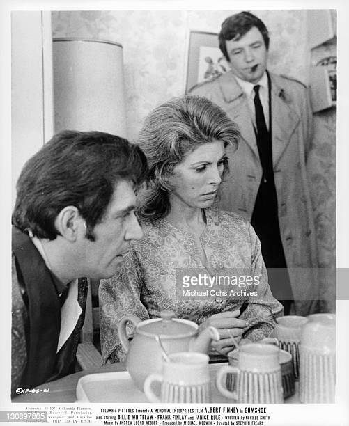 Albert Finney and Billie Whitelaw sitting at a table together in a scene from the film 'Gumshoe', 1971.