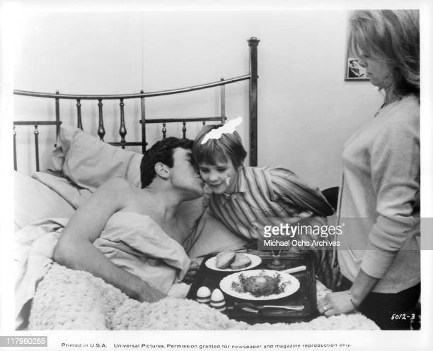 Albert Finney gets breakfast in bed from son Timothy Garland and ex-wife Billie Whitelaw in a scene from the film 'Charlie Bubbles', 1967.