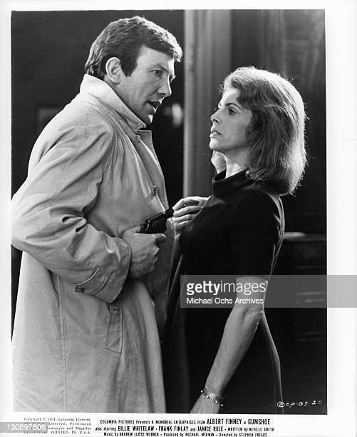 Albert Finney has come to visit Billie Whitelaw with a gun in his hand in a scene from the film 'Gumshoe', 1971.
