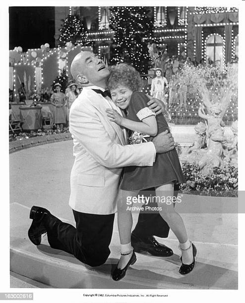 Albert Finney holds Aileen Quinn in a scene from the film 'Annie' 1982