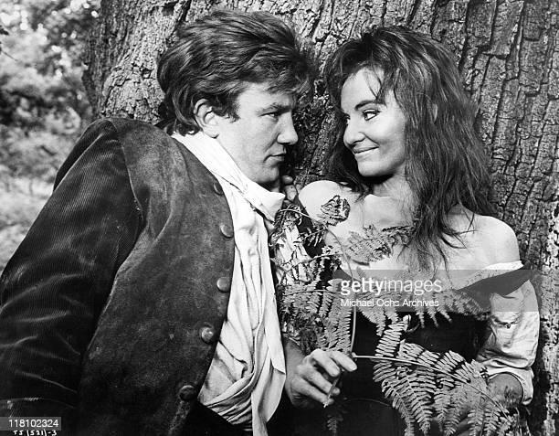 Albert Finney leans into Diane Cilento in a scene from the film 'Tom Jones' 1963