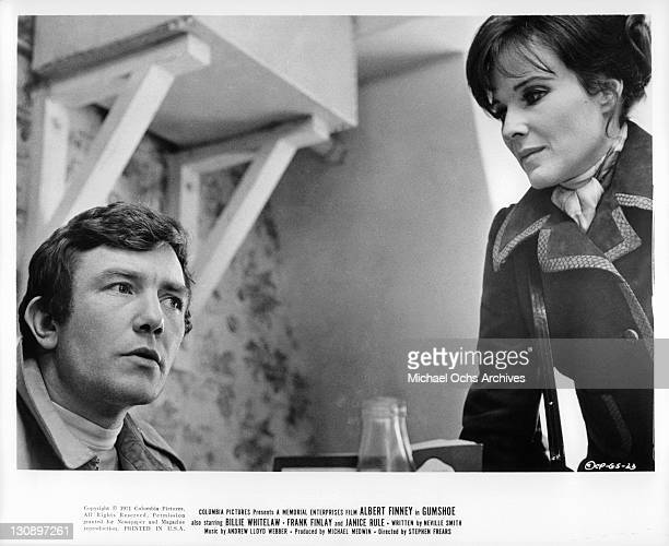 Albert Finney listens to Janice Rule in a scene from the film 'Gumshoe' 1971