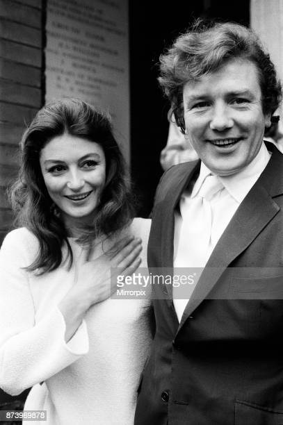 Albert Finney marries French actress Anouk Aimee at Kensington registry Office After the ceremony the bride left the Register Office wearing no ring...