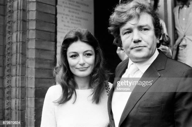 Albert Finney marries French actress Anouk Aimee at Kensington registry Office. After the ceremony the bride left the Register Office wearing no...