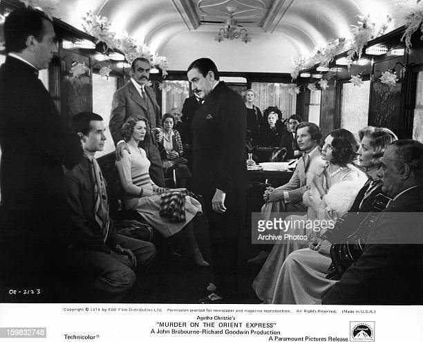Albert Finney questions passengers in a scene from the film 'Murder On The Orient Express', 1974.