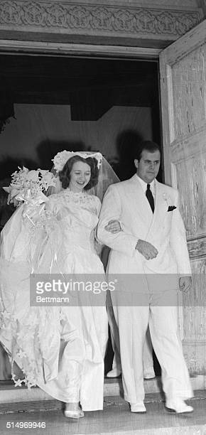 Albert Francis Capone is shown with his bride the former Dianaruth Casey as they left St Patrick's Church in Miami after their marriage The groom is...