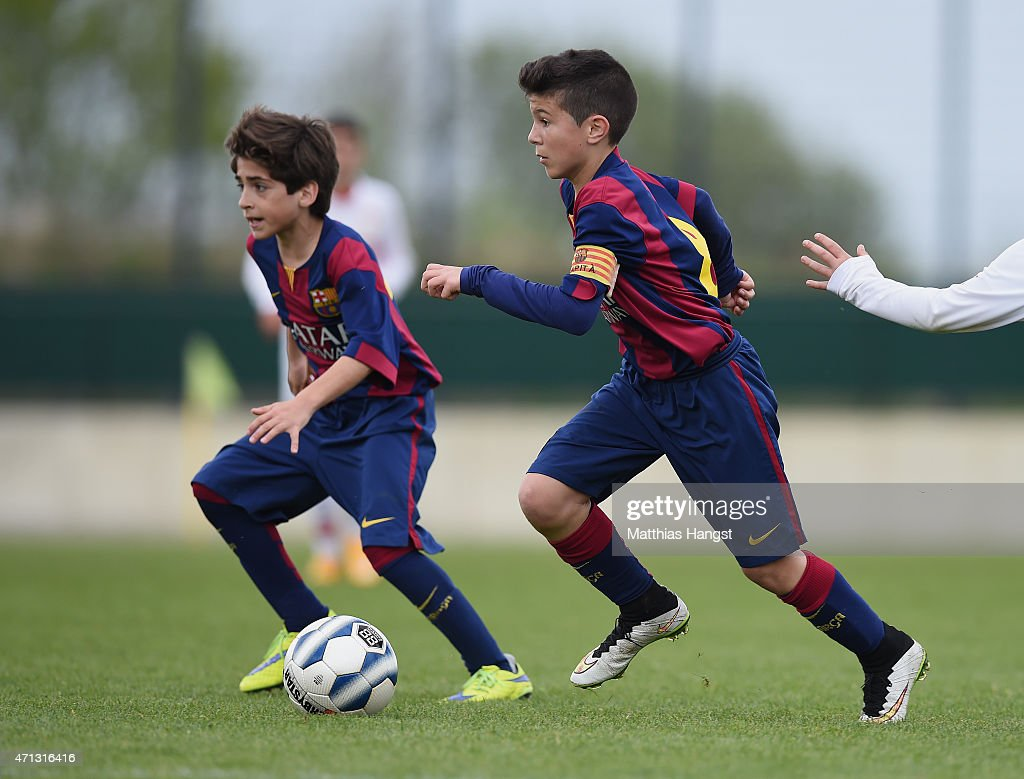 Albert Garrido Rubio (R) of Barcelona and Matias Rafael Lacava (L) of Barcelona control the ball during the Final of the Santander Cup for U13 teams between FC Barcelona and VfB Stuttgart at Borussia Park Fohlenplatz on April 26, 2015 in Moenchengladbach, Germany.