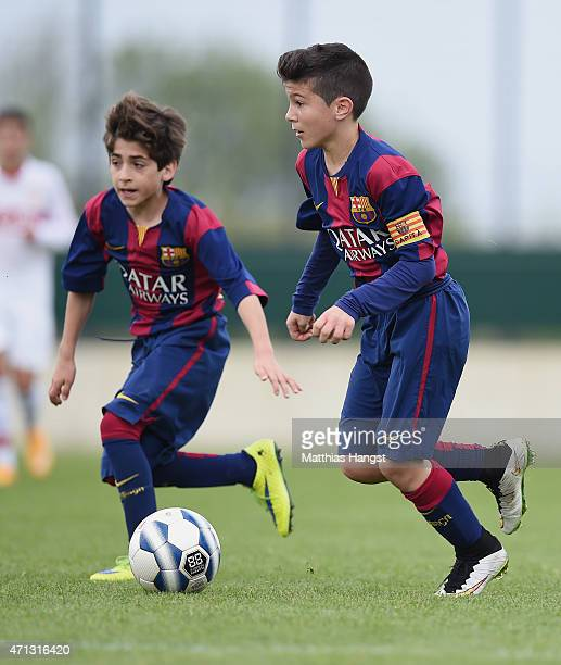 Albert Garrido Rubio of Barcelona and Matias Rafael Lacava of Barcelona control the ball during the Final of the Santander Cup for U13 teams between...