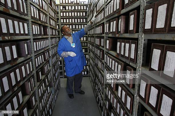 Albert Gaskin , caretaker at Evergreen Cemetery in Los Angles looks over the many cremated remains of unclaimed bodies that are being stored in the...