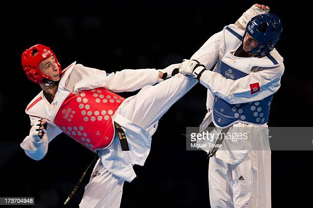 Albert Gaun of Rusia competes with Saifeddine Trabelsi of Tunissia during the men«s 74 kg semifinals of the WTF World Taekwondo Championships 2013 at...