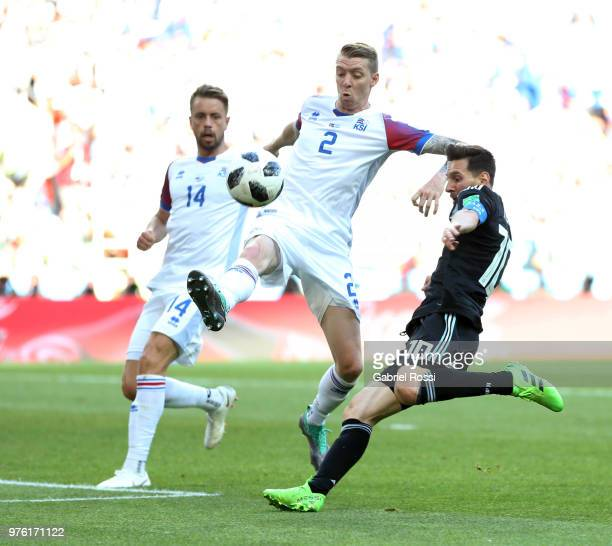 Albert Gudmundsson and Birkir Saevarsson of Iceland battle for possession with Lionel Messi of Argentina during the 2018 FIFA World Cup Russia group...