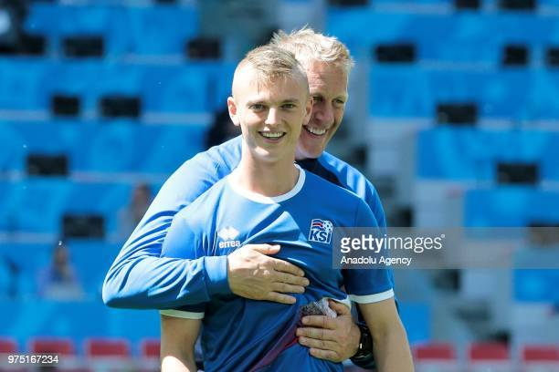 Albert Gudmundsson and head coach Heimir Hallgrimsson are seen during the Iceland national football team training session at the Spartak Stadium...