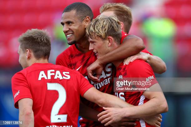 Albert Gudmundsson of Alkmaar Zaanstreek celebrates with teammates after scoring his team's third goal during the UEFA Champions League qualification...