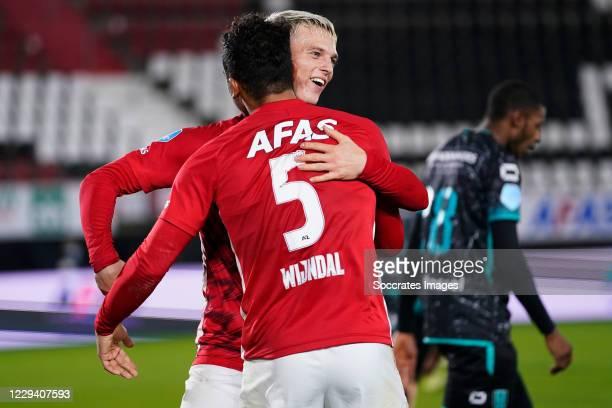 Albert Gudmundsson of AZ Alkmaar celebrates Owen Wijndal of AZ Alkmaar during the Dutch Eredivisie match between AZ Alkmaar v RKC Waalwijk at the...