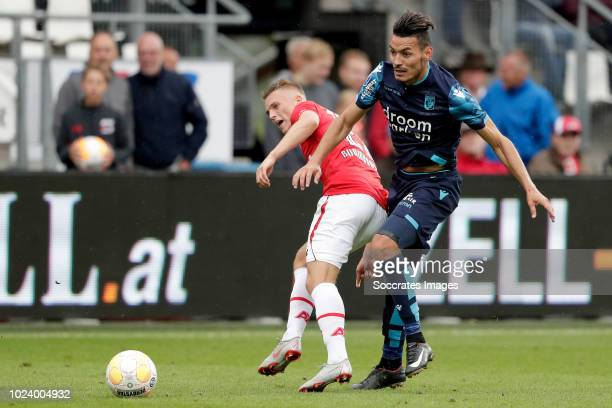 Albert Gudmundsson of AZ Alkmaar Oussama Darfalou of Vitesse during the Dutch Eredivisie match between AZ Alkmaar v Vitesse at the AFAS Stadium on...