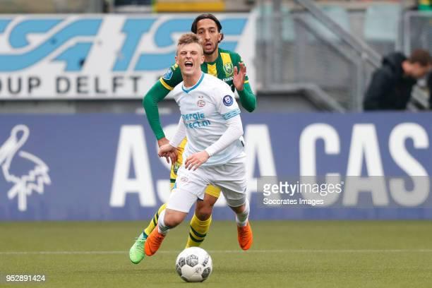 Albert Gudmundsson of PSV Nasser El Khayati of ADO Den Haag during the Dutch Eredivisie match between ADO Den Haag v PSV at the Cars Jeans Stadium on...