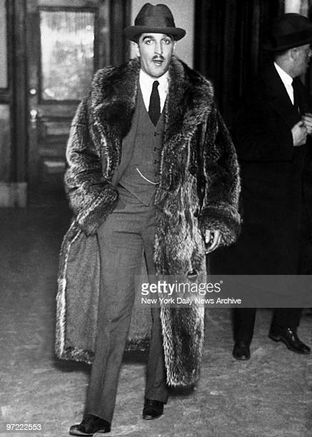 Albert Guimares known as The man in the fur coat A friend of slain model Dorothy King held in murder case Lying in a bed an empty chloroform vial and...