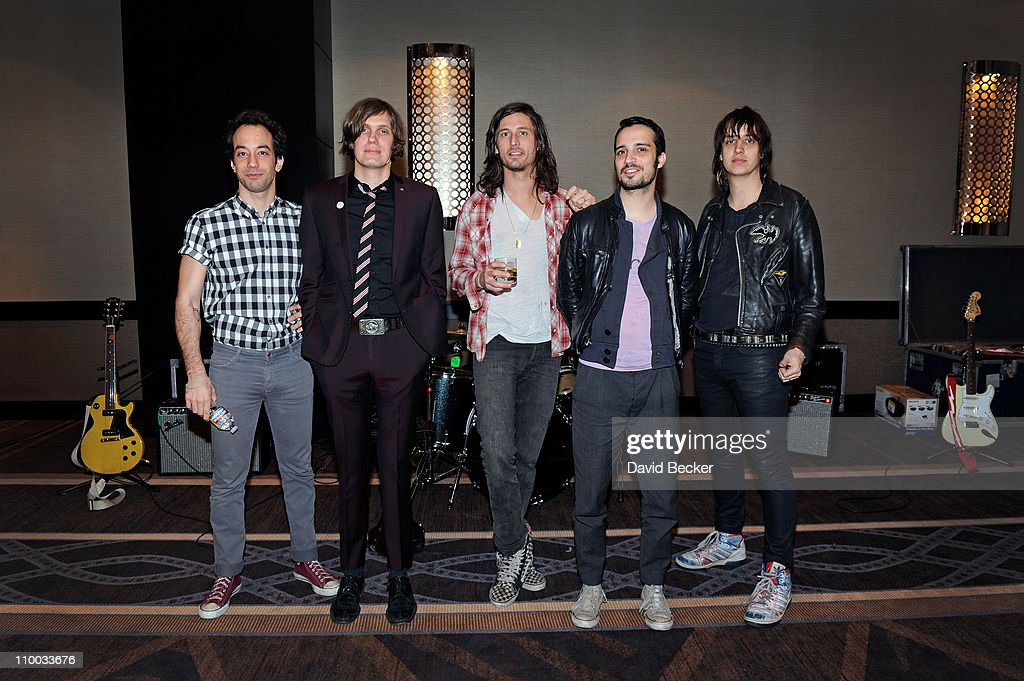Albert Hammond Jr, Nikolai Fraiture, Nick Valensi, Fabrizio Moretti and Julian Casablancas of The Strokes attend a meet and greet prior to their concert at The Cosmopolitan of Las Vegas on March 12, 2011 in Las Vegas, Nevada.
