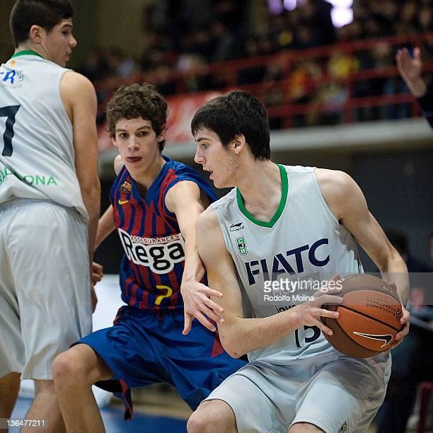 L'HOSPITALET DE LLOBREGAT SPAIN JANUARY 06 Albert Homs #15 of Fiatc Joventut competes with Oriol Pauli #7 of FC Barcelona Regal during the Semi Final...