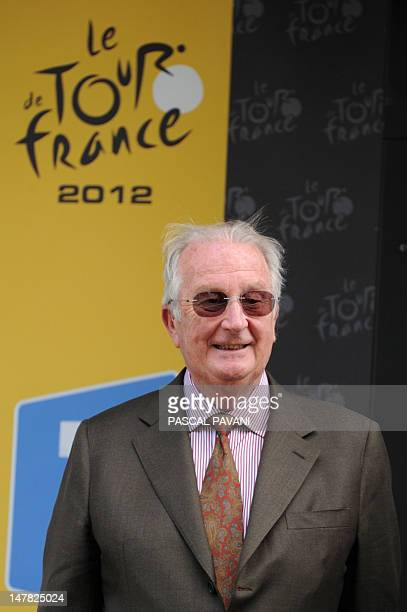 Albert II King of the Belgians stands on the podium at the end of the 2075 km and second stage of the 2012 Tour de France cycling race starting in...