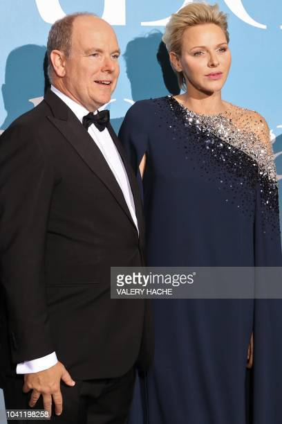Albert II of Monaco and Charlene of Monaco pose upon their arrival at the 2nd MonteCarlo Gala for the Global Ocean 2018 held in Monaco on September...
