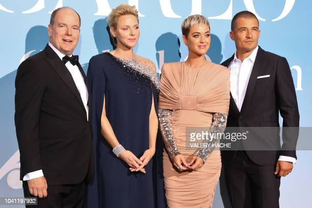 Albert II of Monaco and Charlene of Monaco pose with US singer Katy Perry and British actor Orlando Bloom upon their arrival at the 2nd MonteCarlo...