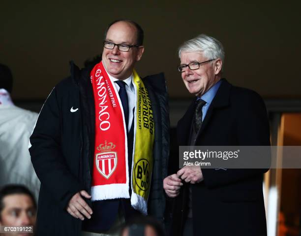 Albert II Prince of Monaco chats to Reinhard Rauball President of Borussia Dortmund during the UEFA Champions League Quarter Final second leg match...
