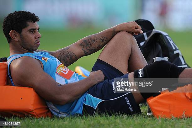 Albert Kelly is seen with an ice pack on his right knee during a Gold Coast Titans NRL training session at Tugun Rugby League Field on March 28 2014...