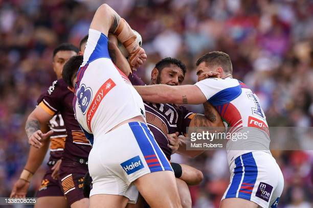Albert Kelly of the Broncos is tackled during the round 25 NRL match between the Brisbane Broncos and the Newcastle Knights at Suncorp Stadium, on...