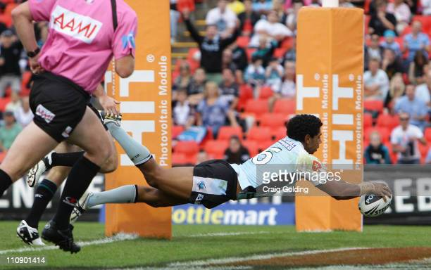Albert Kelly of the Sharks scores during the round three NRL match between the Penrith Panthers and the Cronulla Sharks at Centrebet Stadium on March...