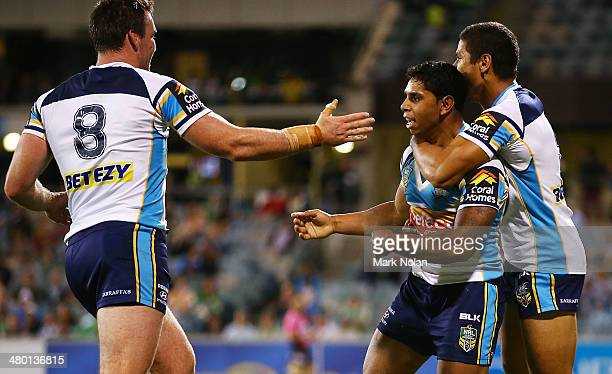 Albert Kelly of the Titans celebrates a try with team mates during the round three NRL match between the Canberra Raiders and the Gold Coast Titans...