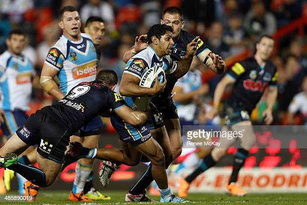Albert Kelly of the Titans is tackled by Kevin Kingston during the round seven NRL match between the Penrith Panthers and the Gold Coast Titans at...
