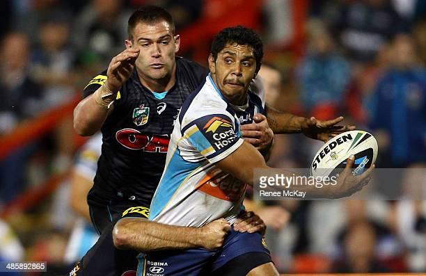 Albert Kelly of the Titans is tackled by Tim Grant during the round seven NRL match between the Penrith Panthers and the Gold Coast Titans at...
