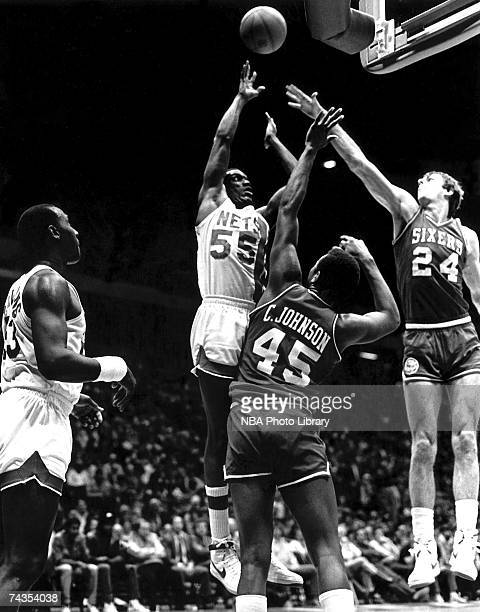 Albert King of the New Jersey Nets attempts a shot against the Philadelphia 76ers during a 1981 NBA game at Brendan Byrne Arena in East Rutherford...