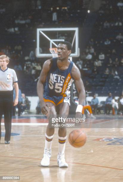 Albert King of the New Jersey Nets dribbles the ball against the Washington Bullets during an NBA basketball game circa 1984 at the Capital Centre in...