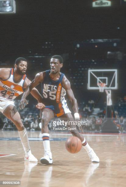 Albert King of the New Jersey Nets drives on Greg Ballard of the Washington Bullets during an NBA basketball game circa 1984 at the Capital Centre in...