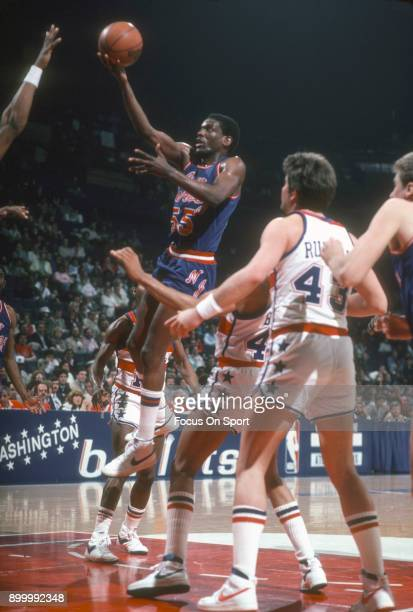 Albert King of the New Jersey Nets goes up for a layup against the Washington Bullets during an NBA basketball game circa 1983 at the Capital Centre...