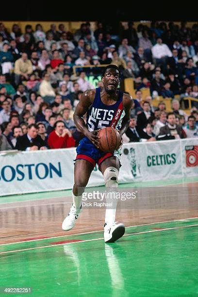 Albert King of the New Jersey Nets goes up for the layup against the Boston Celtics during a game circa 1986 at the Boston Garden in Boston...