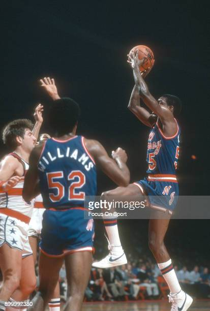 Albert King of the New Jersey Nets goes up to shoot against the Washington Bullets during an NBA basketball game circa 1983 at the Capital Centre in...