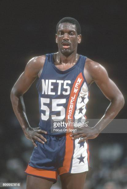 Albert King of the New Jersey Nets looks on against the Washington Bullets during an NBA basketball game circa 1984 at the Capital Centre in Landover...