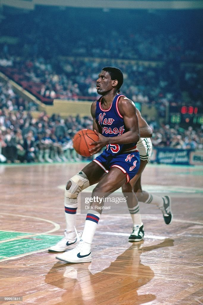 Albert King #55 of the New Jersey Nets looks to make a play against the Boston Celtics during a game played in 1983 at the Boston Garden in Boston, Massachusetts.
