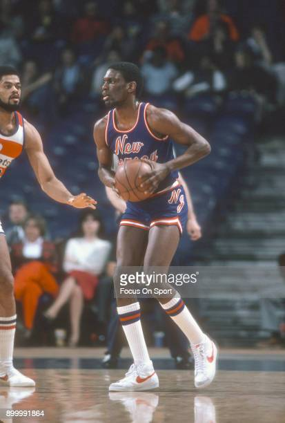 Albert King of the New Jersey Nets looks to pass the ball against the Washington Bullets during an NBA basketball game circa 1983 at the Capital...