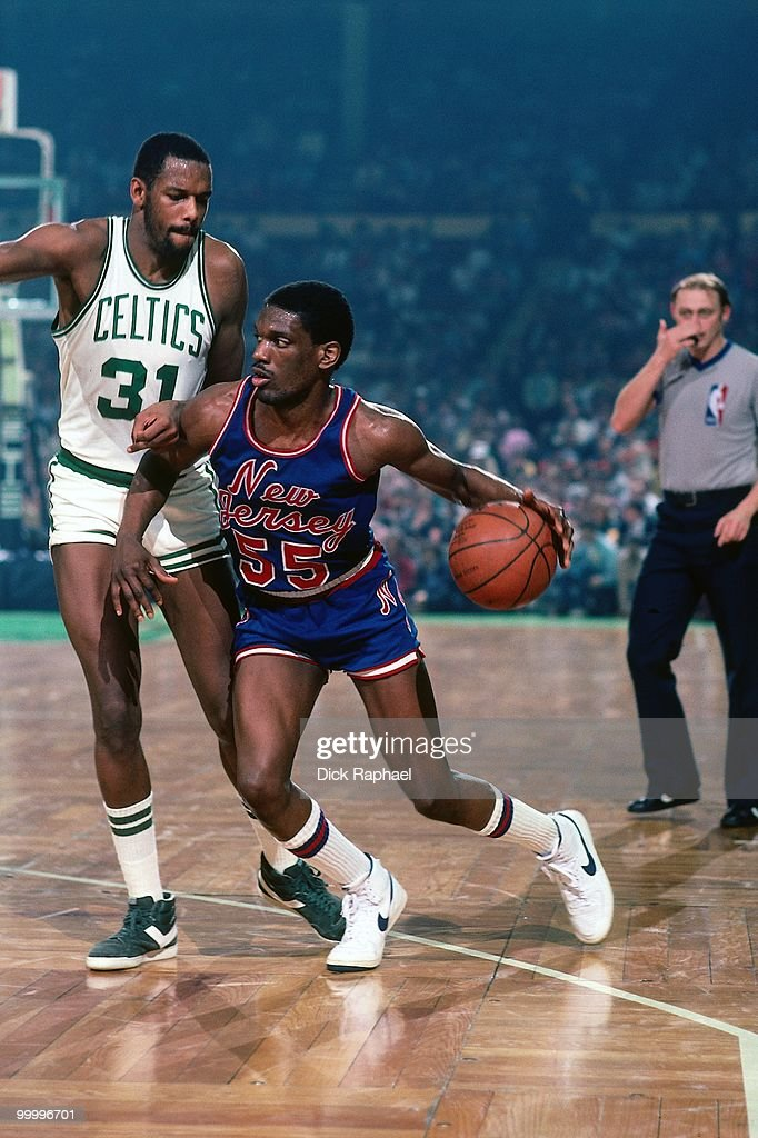 Albert King #55 of the New Jersey Nets moves the ball against Cedric Maxwell #31 of the Boston Celtics during a game played in 1983 at the Boston Garden in Boston, Massachusetts.