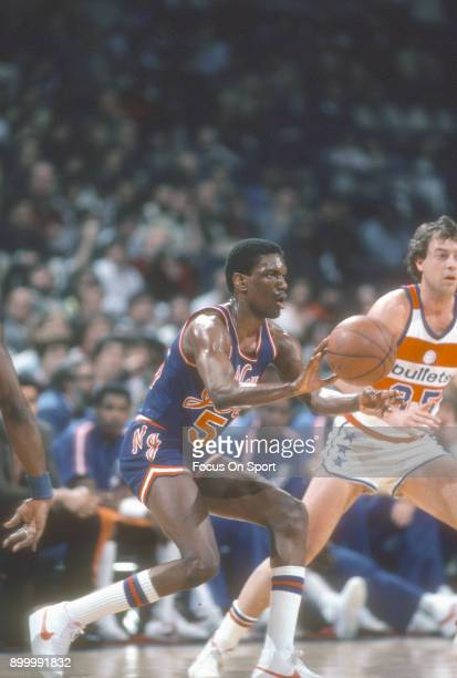 Albert King of the New Jersey Nets passes the ball against the Washington Bullets during an NBA basketball game circa 1983 at the Capital Centre in...
